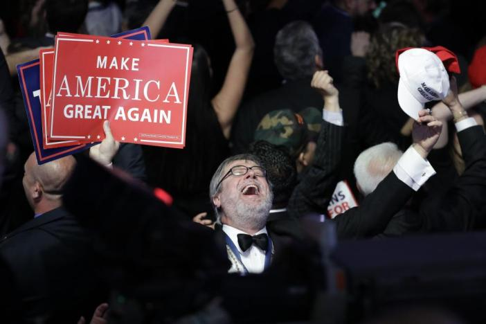 A supporters of Republican presidential candidate Donald Trump reacts as he watches the election results which are now heavily in Trump's favour.