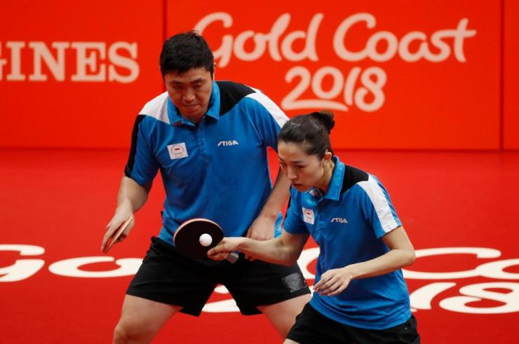 Gao Ning and Yu Mengyu of Singapore in action in the final of the mixed doubles table tennis.