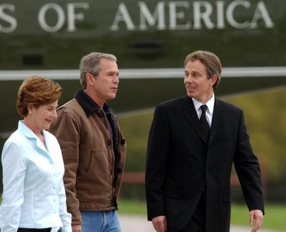President Bush and first lady Laura Bush greet British Prime Minister Tony Blair on his arrival at the Bush ranch in Crawford, Texas, Saturday, April 5, 2002.