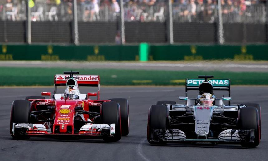 Sebastian Vettel (L) of Scuderia Ferrari and British Formula One driver Lewis Hamilton of Mercedes earlier.