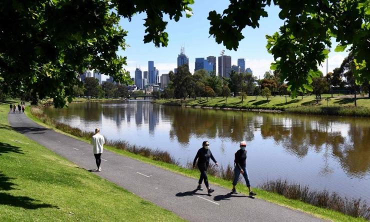 People enjoy the spring weather along the banks of Melbourne's Yarra River on October 16, 2020, as Australia's Victoria state records only two new Covid-19 coronavirus cases and no deaths, the lowest daily figure since 9 June.