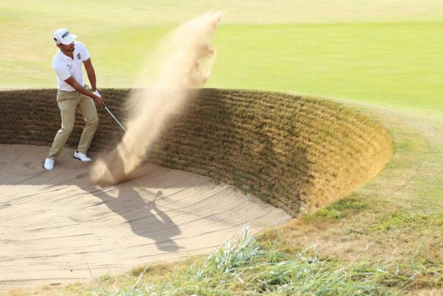 Satoshi Kodaira gets acquainted with the Carnoustie sand.