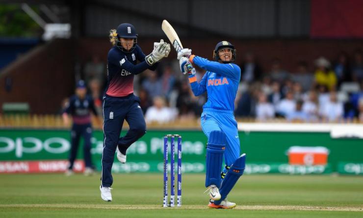 India's Smrti Mandhana hits a six watched by Sarah Taylor.