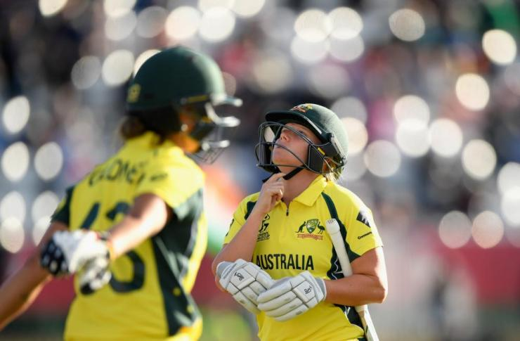 Alyssa Healy walks after being caught.