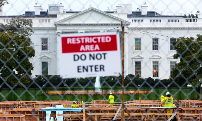 Construction workers begin assembly of the reviewing stand for President Elect Donald Trump's inauguration outside the White House in Washington, DC, on 9 November.