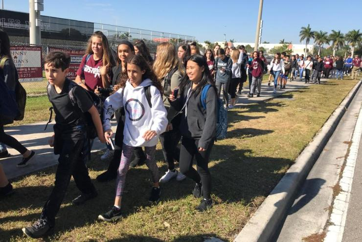Students walk out of Marjory Stoneman Douglas High School in Parkland, Florida
