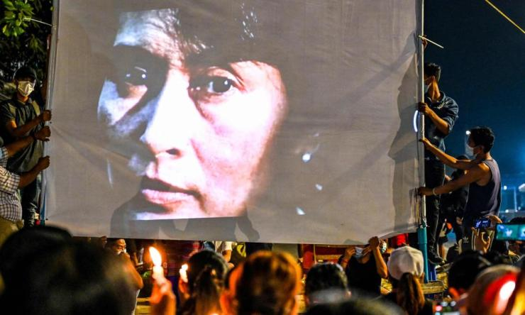 An image of detained civilian leader Aung San Suu Kyi is projected on a screen