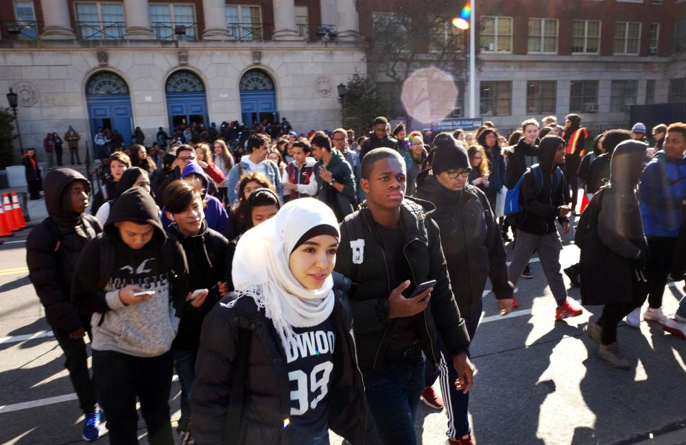 Hundreds of students walk out of Midwood High School in Brooklyn, New York