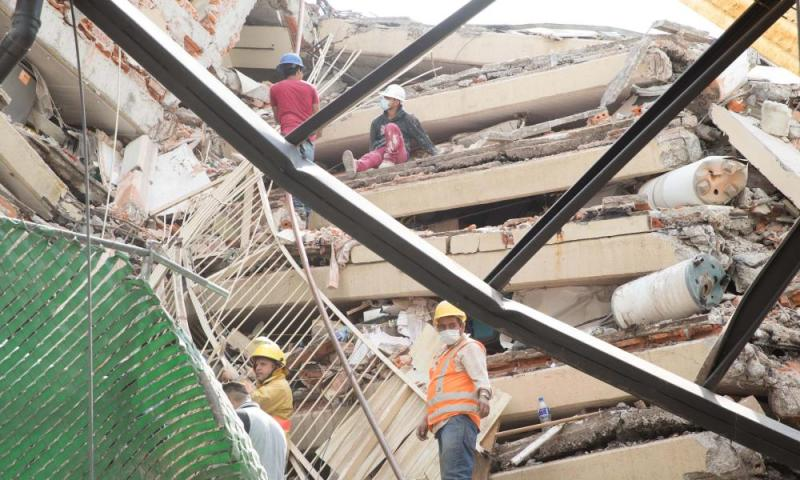 People search for survivors in a collapsed building in Mexico City Earthquake hits Mexico City - 19 Sep 2017