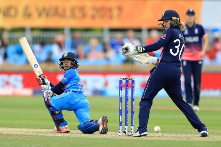 Poonam Raut looks on as she edges the ball past Sarah Taylor.