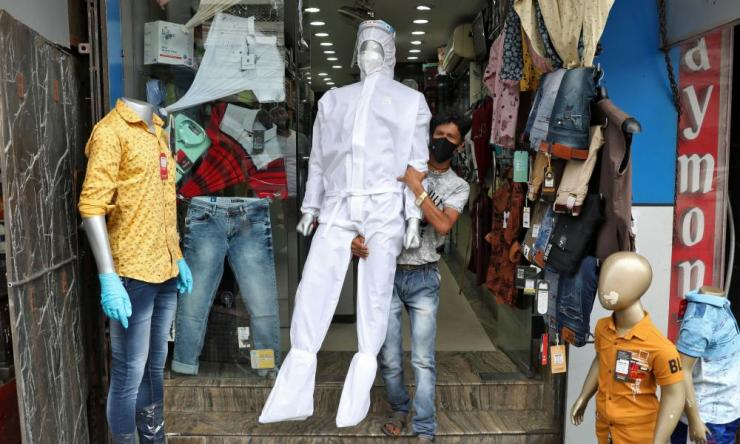 A mannequin displaying protective gear is placed outside a garment shop in Kolkata as India eases lockdown restrictions.