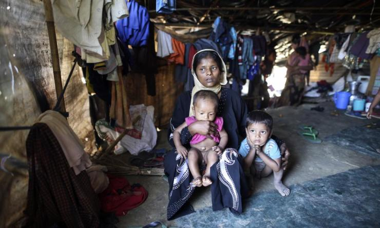 A Rohingya mother and her children shelter at a refugee camp at Cox's Bazar.