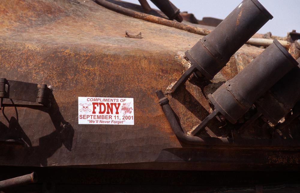 Iraq. US sticker on burned out Iraqi tank