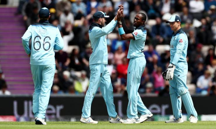 Jofra Archer of England is congratulated by his teammates after taking the wicket of Carlos Brathwaite of West Indies.