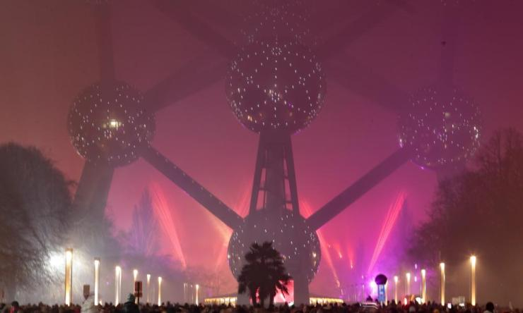 Fireworks light up in the fog in front of the Atomium Monument in Brussels, Belgium