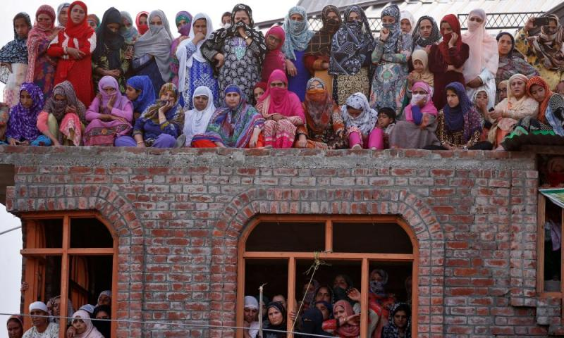 Women watch the body of Dawood Salafi, a suspected militant, during his funeral in Srinagar