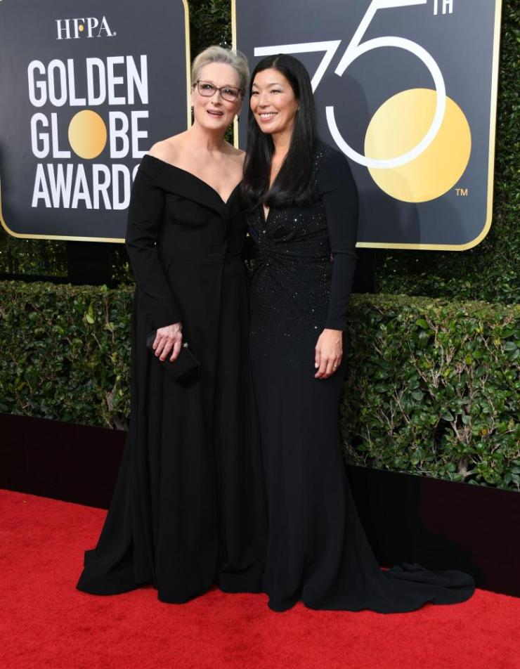 Meryl Streep and Ai-jen Poo, the head of the National Domestic Workers Alliance, arrive for the 75th Golden Globe Awards
