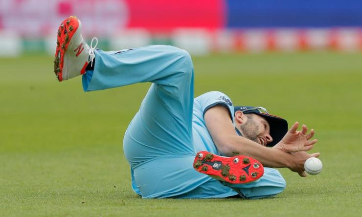 England's Mark Wood drops West Indies' Chris Gayle off the bowling of Chris Woakes.