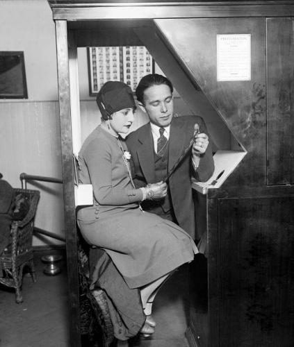 Anatol Josepho and his wife sitting in his Photomaton.