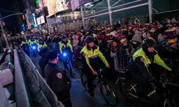 New York Police Department (NYPD) officers secure Times Square during the New Year's Eve celebrations