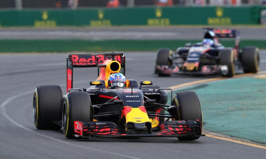 Daniel Ricciardo of Australia and Red Bull Racing drives ahead of Max Verstappen of the Netherlands.