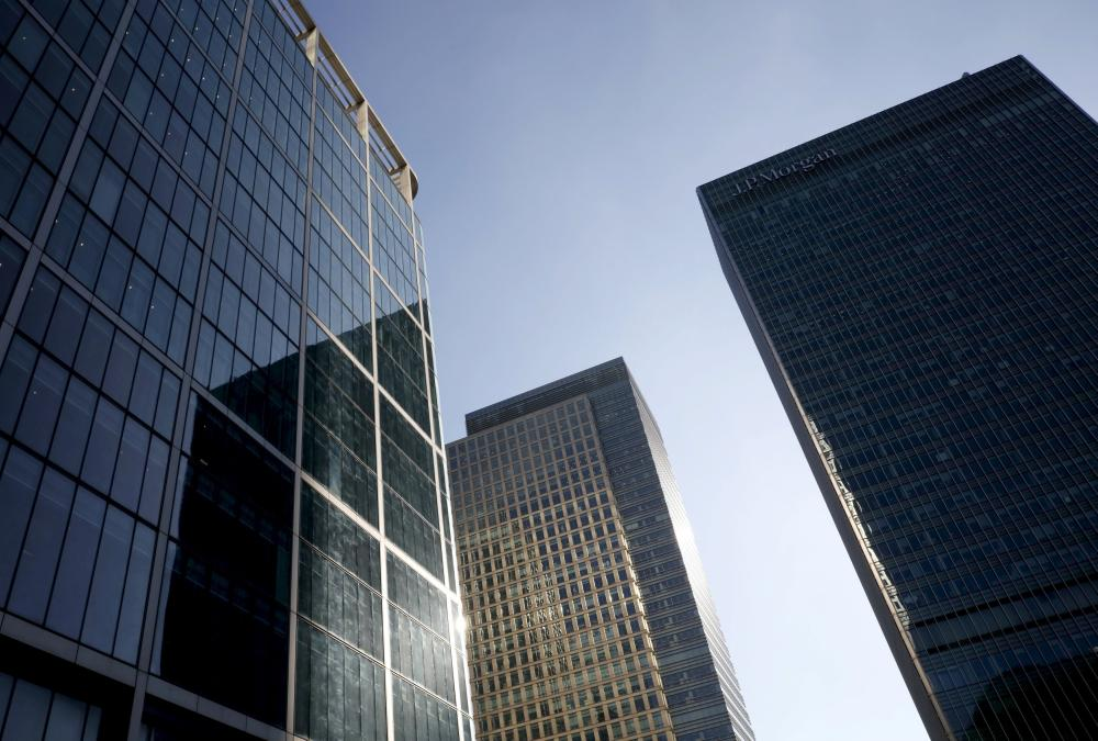 Skyscrapers are seen at Canary Wharf financial district in London, Britain, October 26, 2015. World shares rose on Friday and were on course for their best month in four years, led by Europe's best month in over six years, as global central banks kept stimulus policies intact and many hinted at further steps to re-energise their economies. Picture taken October 26, 2015. REUTERS/Reinhard Krause