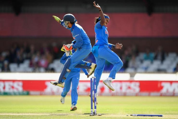 Shika Pandey celebrates with wicketkeeper Sushma Verma after bowling Mooney.
