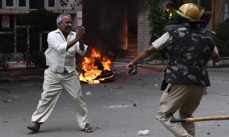 A man appears to plead for his safety during clashes in Panchkula on Friday.