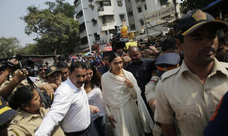 "Bollywood actor Deepika Padukone, centre, arrives escorted by police to offer prayers at a Hindu temple ahead of the release of her upcoming film ""Padmaavat"" in Mumbai on Tuesday"