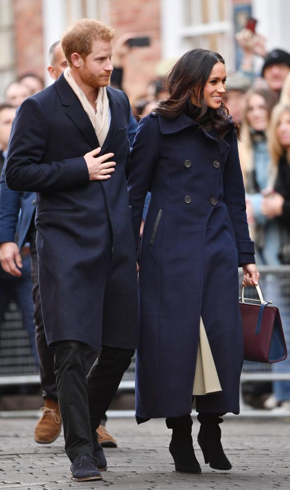 Royal walkabout: Prince Harry and Meghan Markle visit a Terrence Higgins Trust charity fair. But who made her handbag (Q15)?