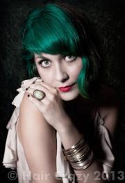 dyes emerald hair with blue