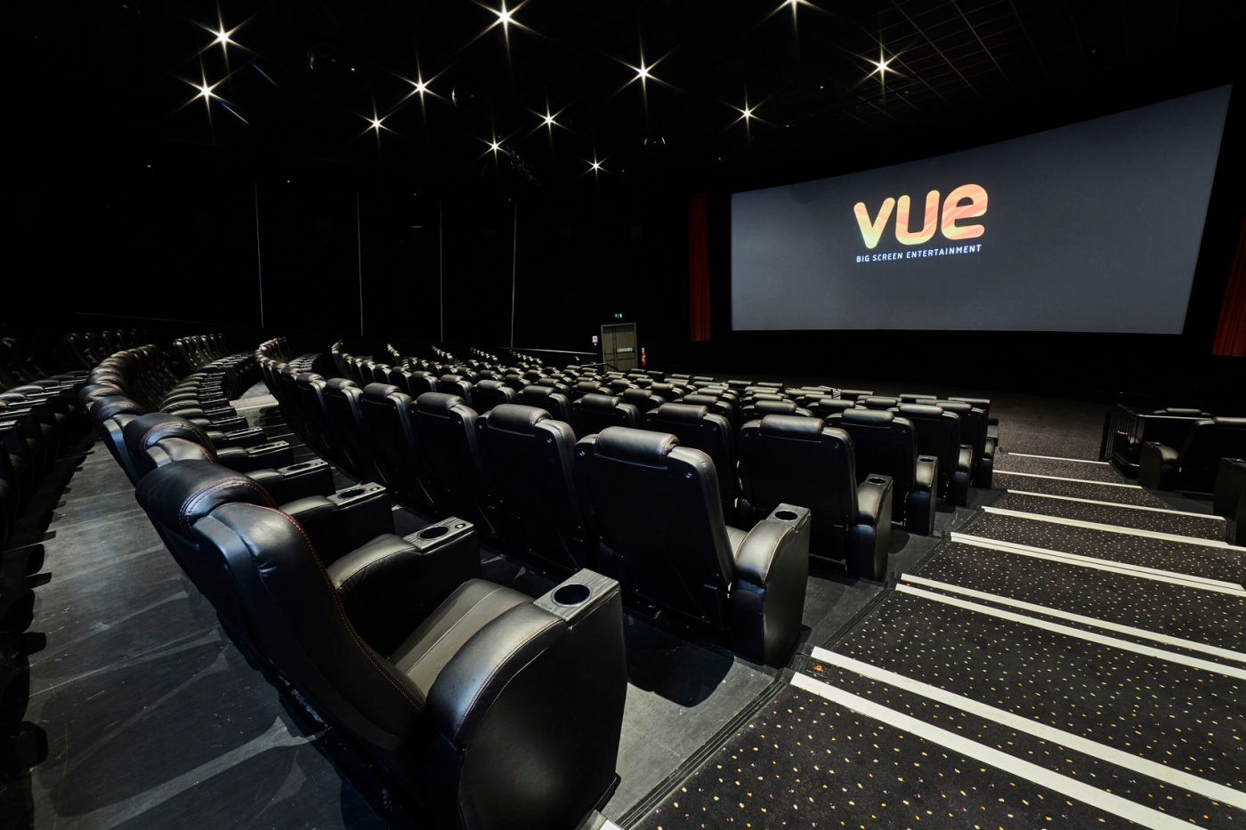 large cinema room with 'Vue' screen