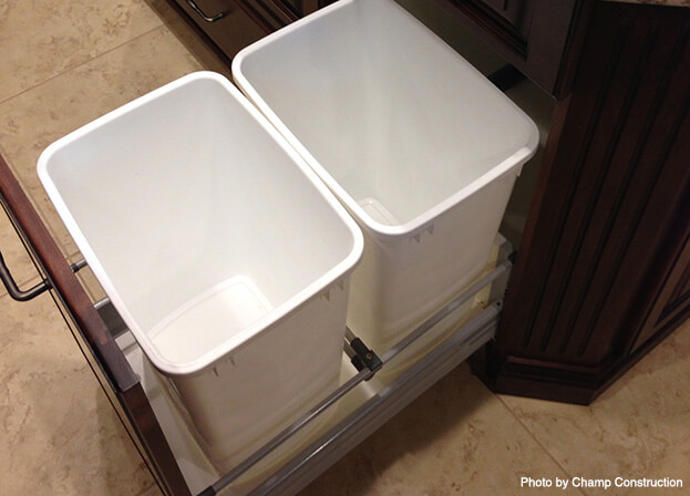 a rollout trash bin concealed inside the cabinet can offer quick access.