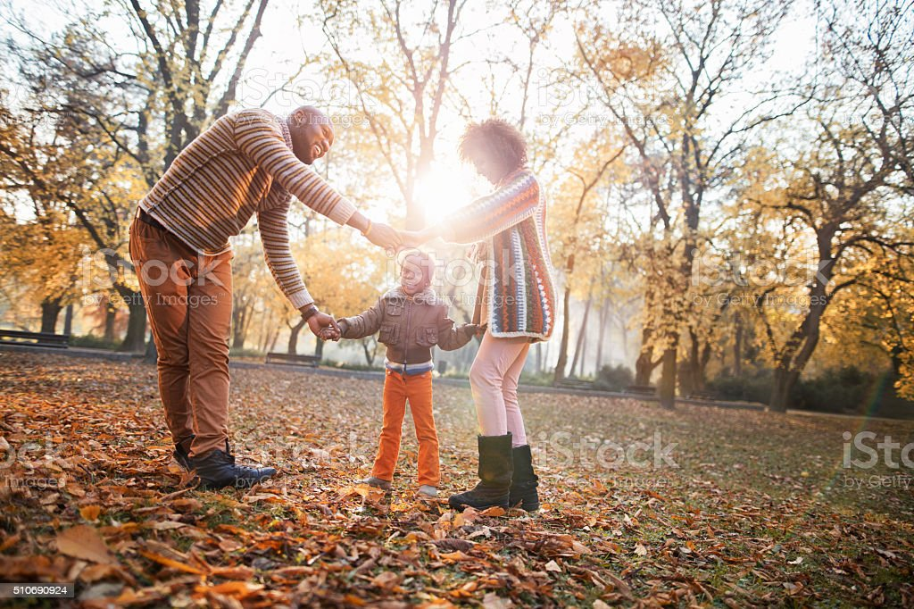 African American Family Playing Ring Around The Rosy In