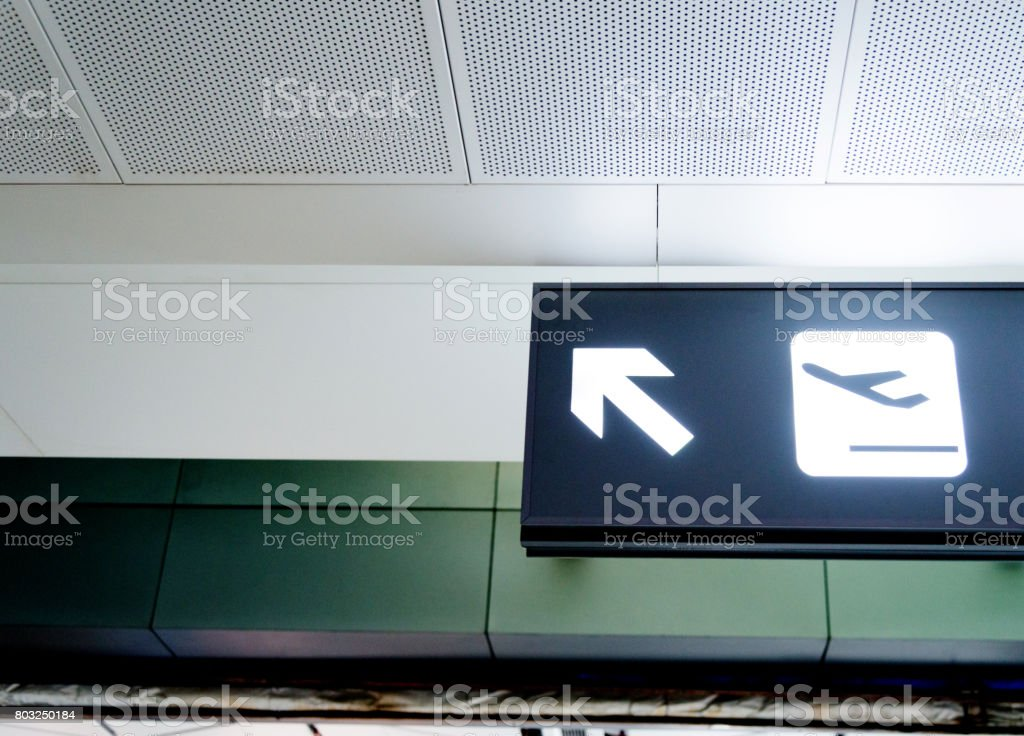 airport departure sign at