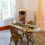 Antique Marble Dining Table And Antique Metal Chair And Refrigerator In A Classic And Modern Kitchen Stock Photo Download Image Now Istock