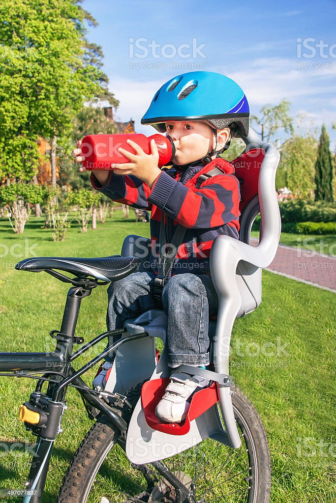 the bike chair banquet hall chairs baby boy is in bicycle stock photo more pictures of seat royalty free
