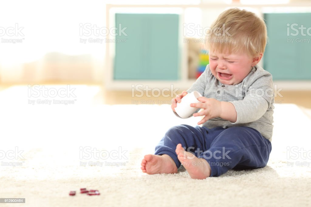 Baby Crying In Danger After Eating Some Pills Stock Photo ...