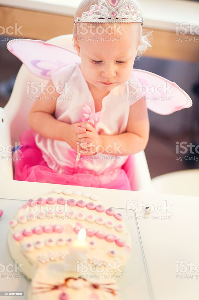 Baby Girl Dressed As Fairy And Birthday Cake Stock Photo More