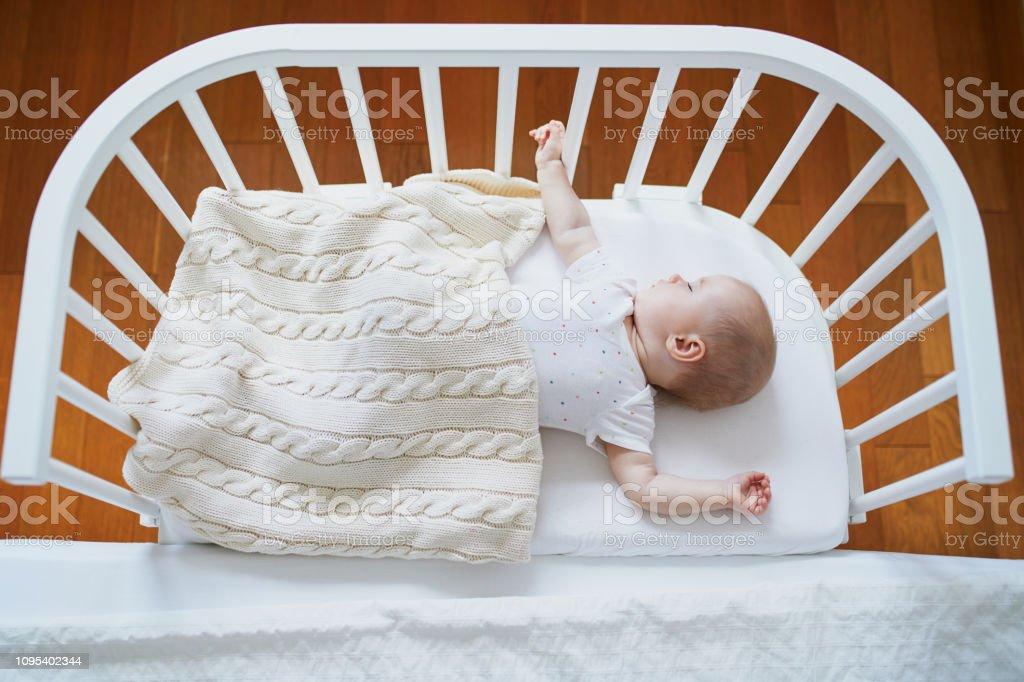baby sleeping in cosleeper