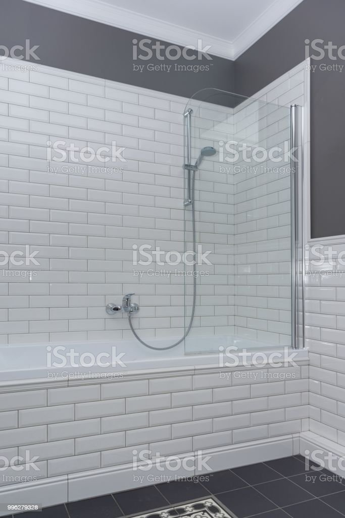 Bathroom Interior Closeup The Walls Are Painted Gray Covered With Decorative Ceramic Tiles With White Glossy Bricks Stock Photo Download Image Now Istock