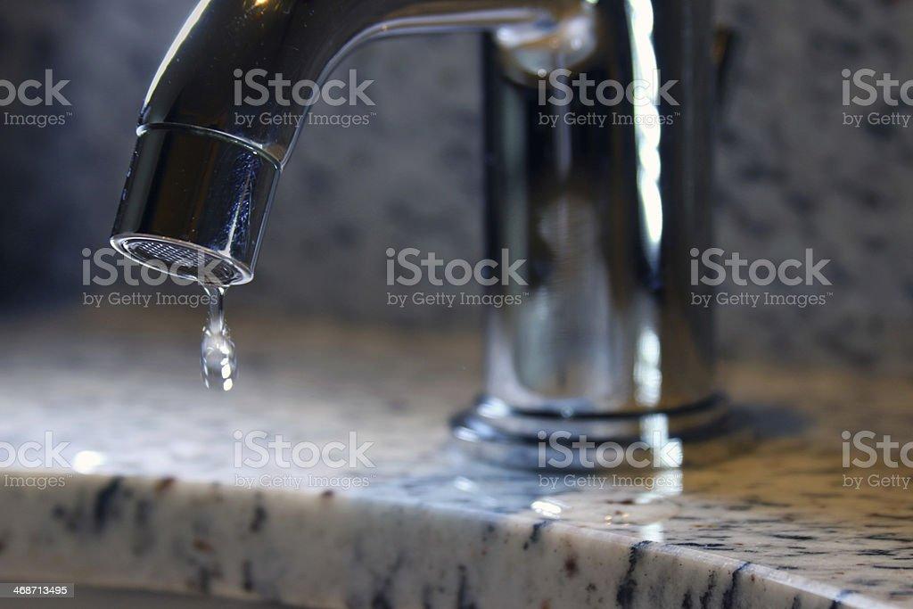 https www istockphoto com photo bathroom sink faucet dripping gm468713495 34757836