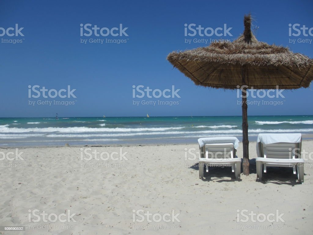 Beach Chairs With Umbrella Beach Chairs And Umbrella On White Sand Beachdjerba Islandtunisia