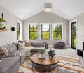 Beautiful Living Room Interior With Colorful Area Rug Large Couch And Abundant Natural Light Stock Photo Download Image Now Istock