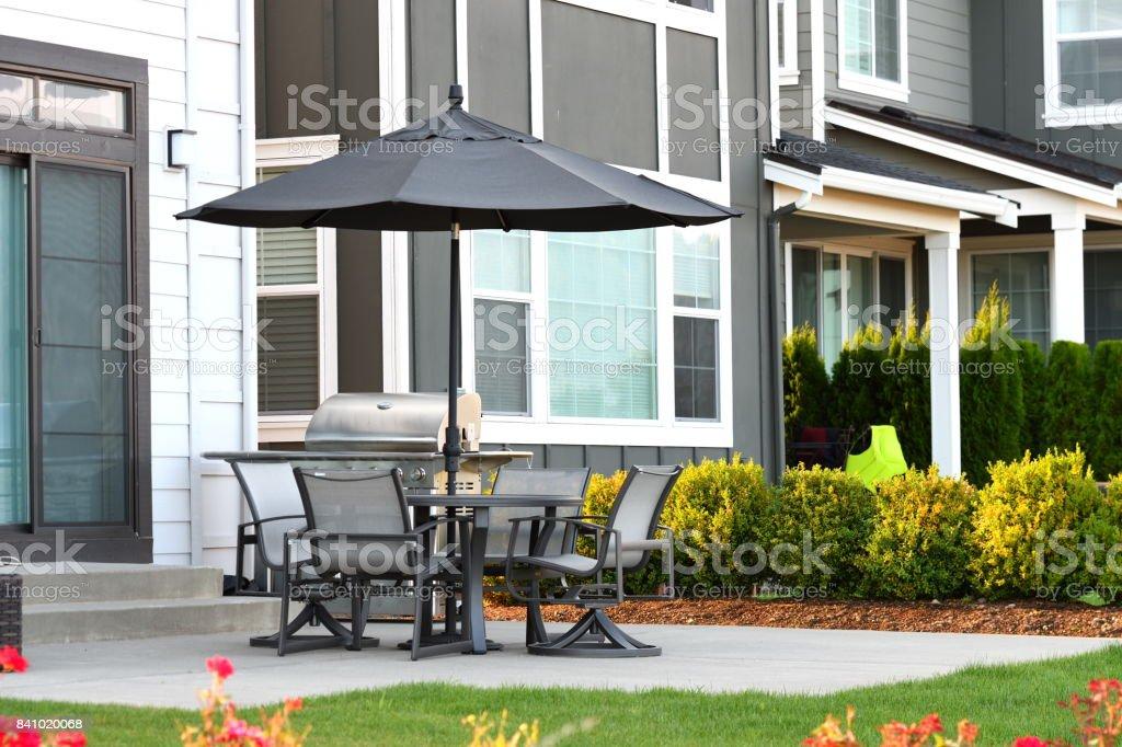 black metal patio furniture set with black umbrella stock photo download image now istock
