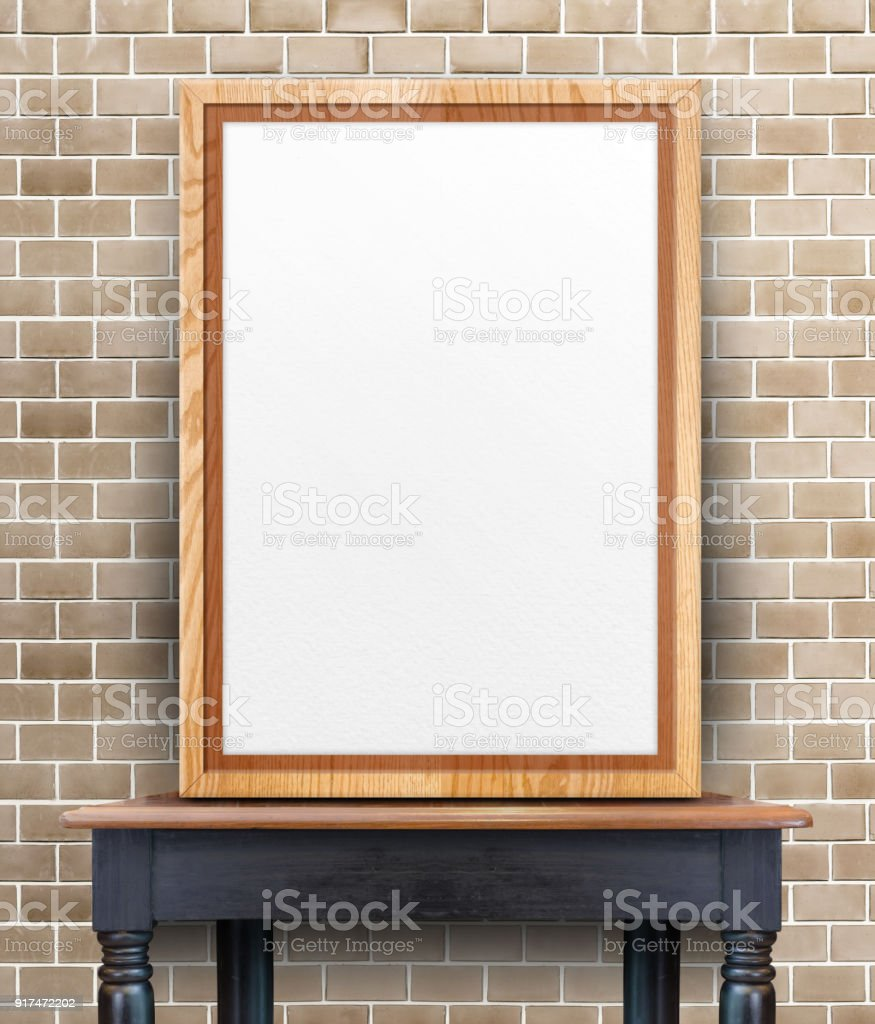 Blank Wooden Photo Frame Leaning At Brick Wall On Vintage Wood Table, Template Mock Up
