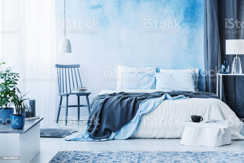 bedroom chair with blanket covers dining room blue next to bed grey in cozy interior plants on white