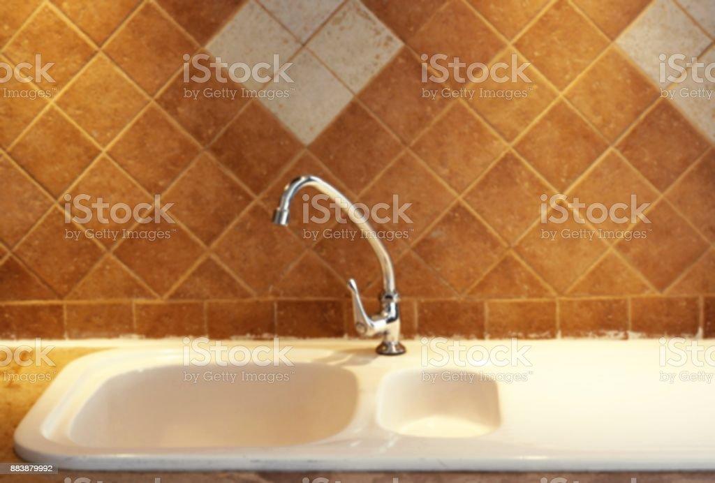 https www istockphoto com photo blur modern white kitchen sink gm883879992 245802741