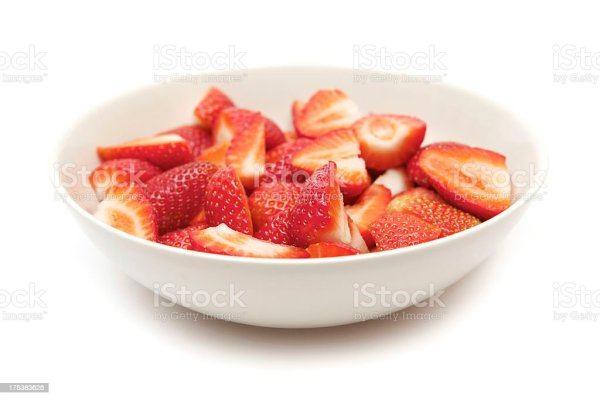 Bowl Of Sliced Strawberries Stock Photo More Pictures of