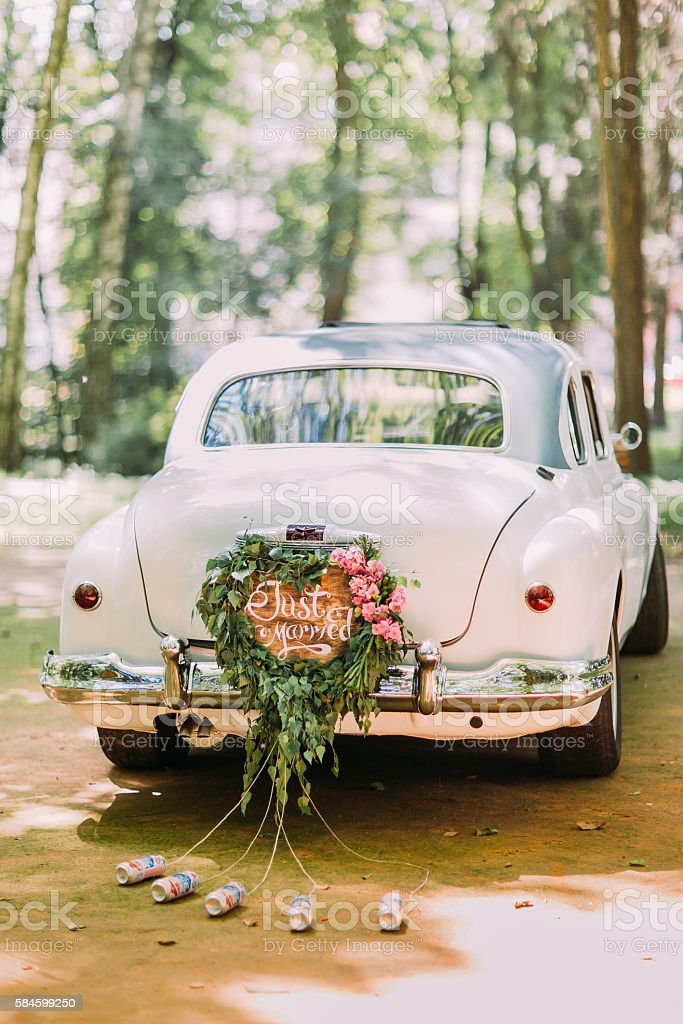 Bumper Of Retro Car With Just Married Sign And Cans Stock